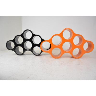 """""""CLOUD"""" shelves. Emblematic pieces by famous designer Ronan and Erwan Bouroullec. Two cloud-shaped storage modules (one black and one orange) made of lacquered fiberglass and open on both sides. The elements can be placed on top of each other or side by side. The set can be used to create a room separation. Very original, design and in good condition. Dimensions: Height: 75.5 cm. One above the other = height 136 cm. Depth: 25 cm. Length: 133 cm."""