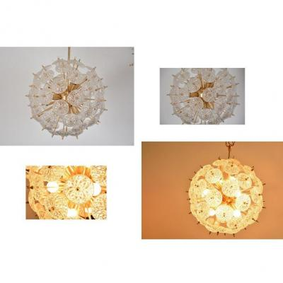 Lustre vintage designer Emil StejnarFabrication Val Saint Lambert (Belgium). A multitude of chiseled crystal discs attached to a brass structure provides a wonderful and magical light. Superb realization, very classy,12 bulbs E14Bon condition Dimensions: as presentDiameter 47 cm Total height 82 cm
