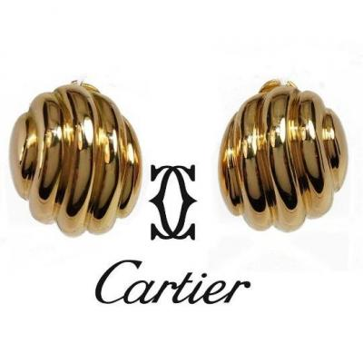 Pair of 18K yellow gold oval earrings signed and numbered from Cartier 1980-1990.<br />