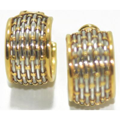 Pair of gold and steel earrings, signed by the house Cartier weaving vision decor model<br /> Numerot&eacute;es:7568305<br /> Poids brut:18grs<br /> Poin&ccedil;on:t&ecirc;te d&#39;aigle<br /> <br /> delivered with invoice secure and free shipping