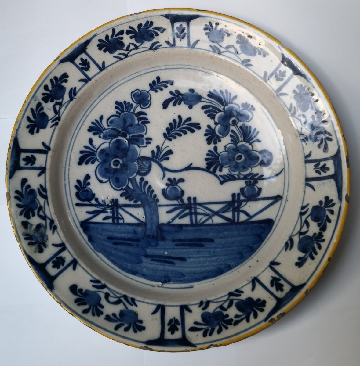 Round Dish In Delft Faience With White And Blue Decor. Eighteenth Century