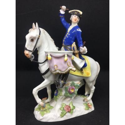 Meissen, military figure playing the drum on a horse. Mark of crossed swords and numbered 1963. Reproduced in the Meissen porcelain catalog. Small restoration in one of the drum sticks.