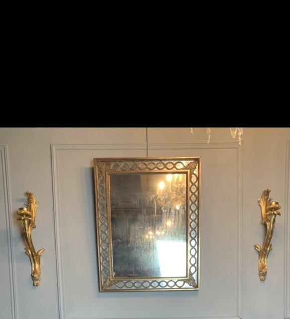 Miroir à Parecloses En Bois Doré.