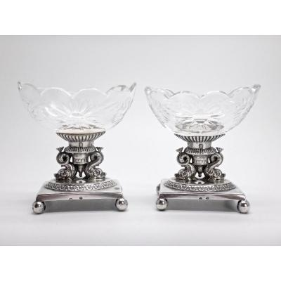 Pair Of Solid Silver Saltcellars In The Empire Style Decorated With Dolphins And Cut Crystal Saltcellars From The 19th Century