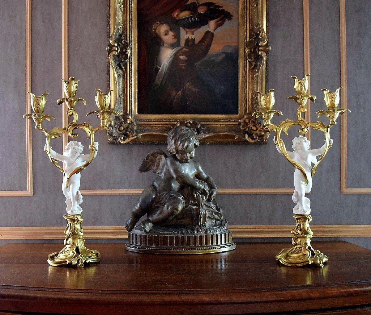 Paire de candélabres bronze et angelots en biscuit de Sèvres XIXème