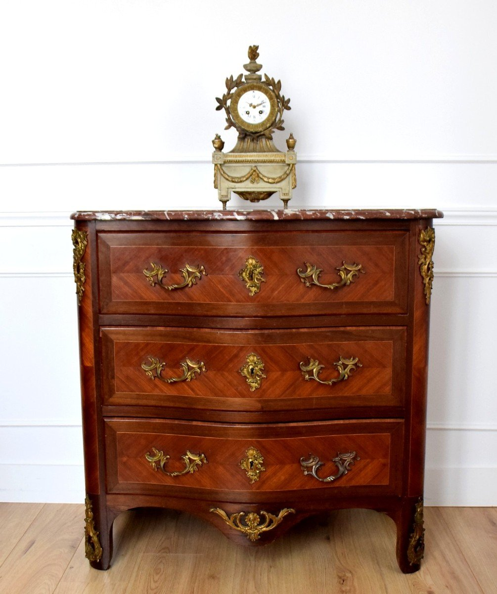 Commode de style Régence en marqueterie XIXème