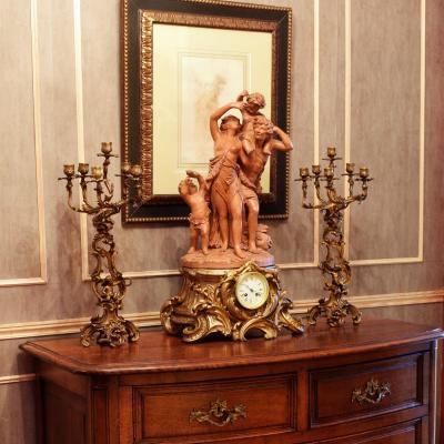 Importante pendule Style L.XV Terre cuite de Clodion XIXème