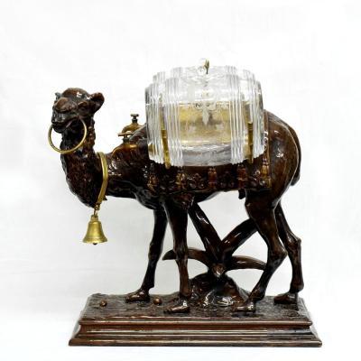 Cave à liqueur orientaliste zoomorphe au chameau en faïence XIXè