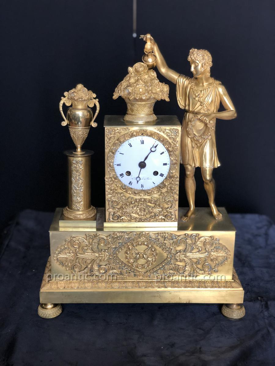 Pendule Empire en bronze doree