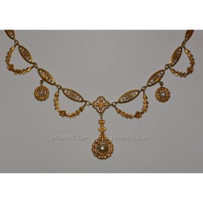 Collier draperie en or jaune 18 carats et perles vers 1910/1920