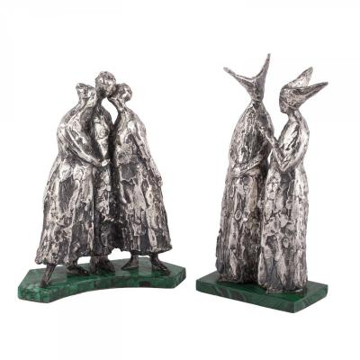 A Pair Of Silver Sculptures