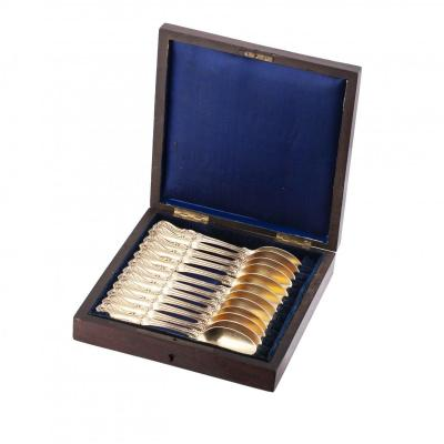 A Set Of 12 French Silver Gilt Dessert Spoons