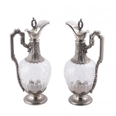 A Pair Of Silver And Cut Glass Claret Jugs