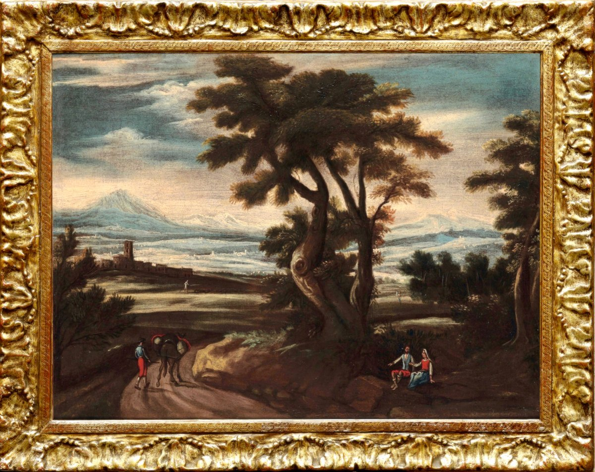 XVII Century Venetian School, Animated Landscape With A Village In The Distance