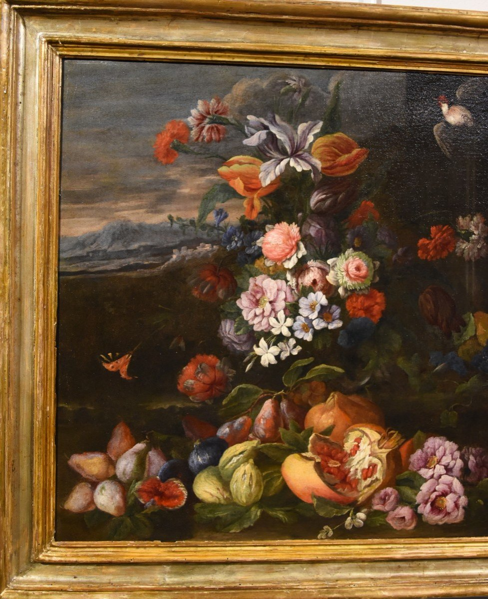 Entourage Of Abraham Brueghel (1631-1697), Still Life Of Flowers And Fruits With Landscape-photo-1