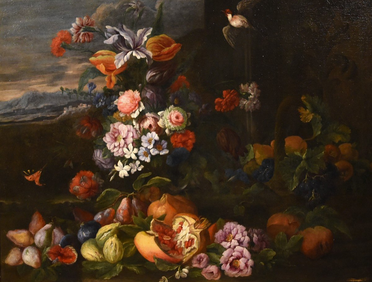 Entourage Of Abraham Brueghel (1631-1697), Still Life Of Flowers And Fruits With Landscape
