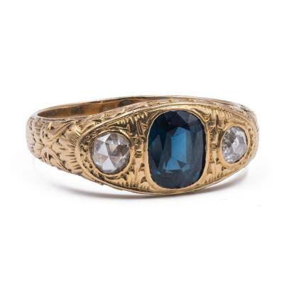Men's Ring In 18 K Gold With Central Sapphire And Sides Diamonds