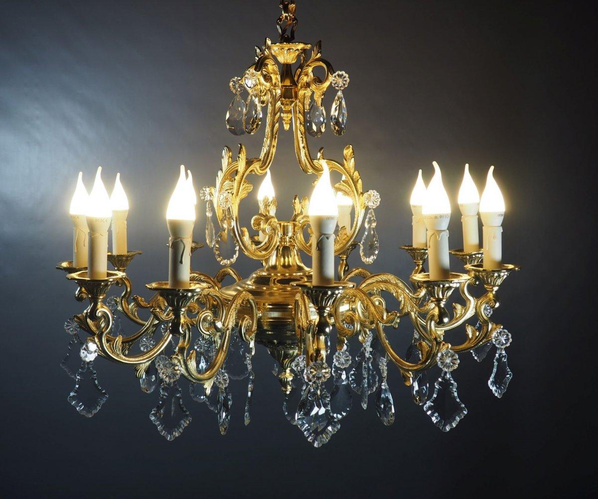 Lustre 12 lumières en bronze doré et cristal