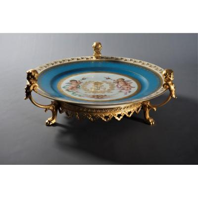 """&nbsp;&quot;S&egrave;vres.The small triumph of Louis-Philippe&quot; Plate<br /> S&egrave;vres plate from the Officers&#39; Service of the Ch&acirc;teau des Tuileries at the time of King Louis-Philippe.<br /> Polychrome and gilded porcelain on a bronze and gilded frame.<br /> Monogram LP (Louis-Philippe) under the crown, in gold. France, S&egrave;vres, 1837. Mark &quot;Ch&acirc;teau Tuileries, &quot;SEVRES LP 1837&quot;, &quot;S.37&quot;.<br /> Diameter 24 cm,<br /> Height 10 cm.<br /> Weight 0.890 kg.<br /> The porcelain is in excellent condition, the bronze has been restored by electrolysis in 24 carat gold.<br /> <br /> For more information,<br /> please visit our website by clicking here: <a href=""""http://www.antik-france.fr"""">www.antik-france.fr</a><br /> <br /> Item 4801"""