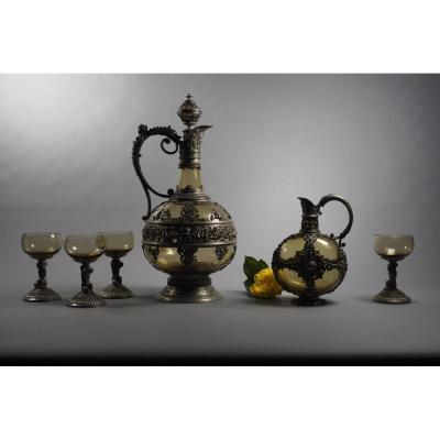 """Liquor service made with colored glass, pewter. France, 19th century. Renaissance style.<br /> Dimensions: large carafe - height 33 cm, small carafe for infusions - height 17 cm, cups - height 10 cm.<br /> The total weight is 2,470 kg.<br /> Excellent condition.<br /> <a href=""""https://antik-france.fr/en/"""">For more information,<br /> please visit our website by clicking here: www.antik-france.fr</a><br /> <br /> &nbsp;"""