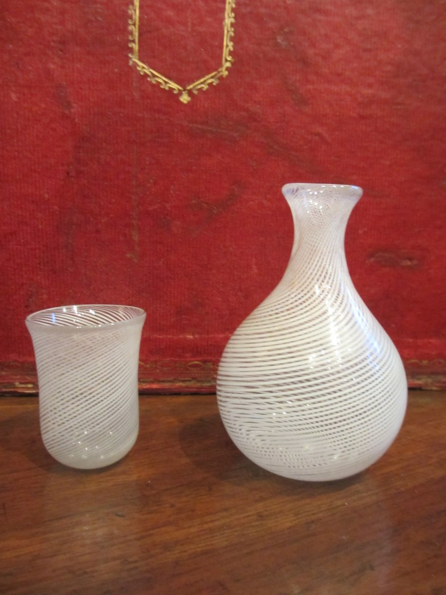 Small Water Carafe And Its Goblet Decorated With A White Filigree