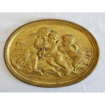 Plaque d'ornement aux angelots, en bronze