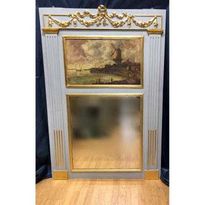 Gray lacquered wood fireplace trumeau, topped with a golden frieze. It is decorated in its lower part with a mirror and in its upper part, with a Dutch navy, taken from Jacob van Ruisdael<br />