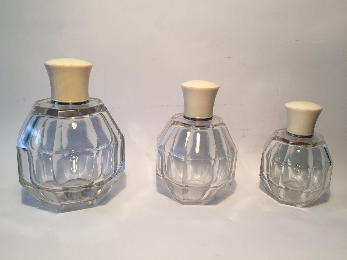 Trois Flacons Art Déco . Cristal et Ivoire.