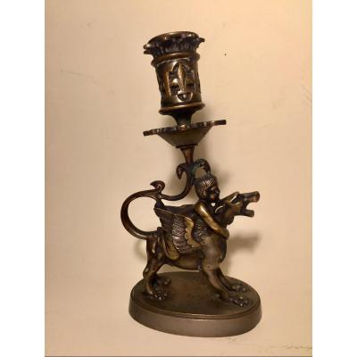 19th Century Bronze Candlestick In Medieval Style. Child On Winged Monster.