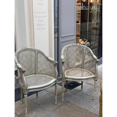 Pair Of Caned Armchairs