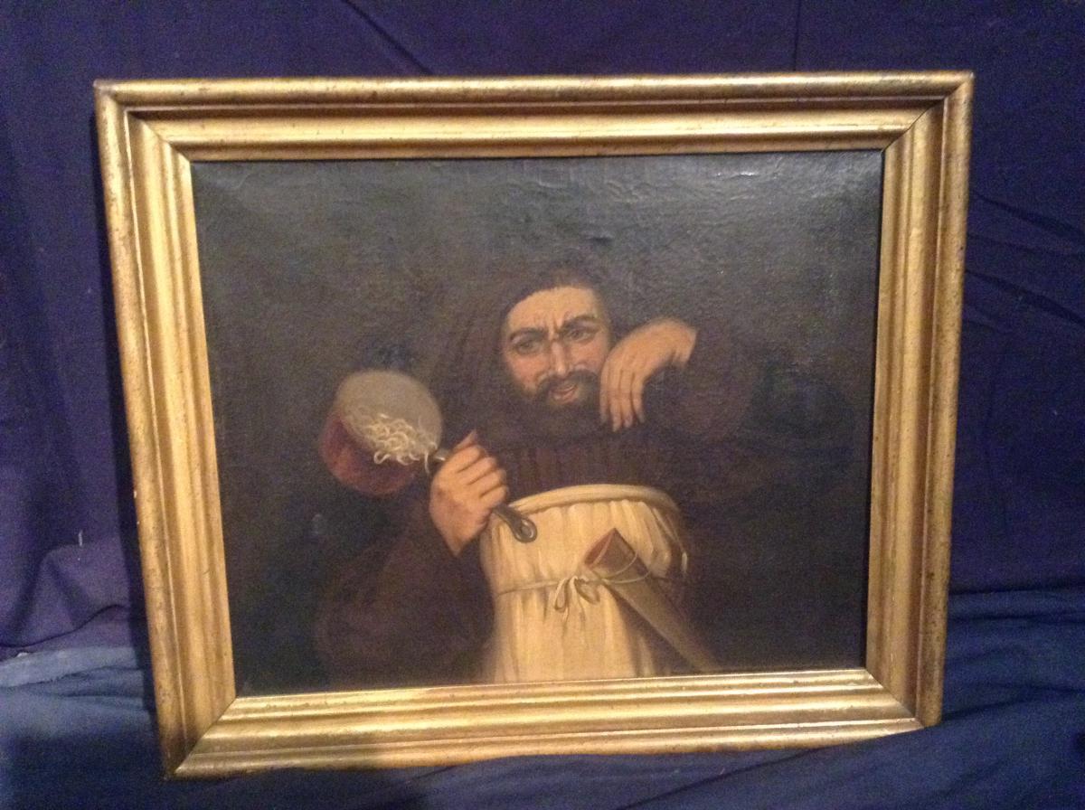 Moine tenant une casserole de pâtes, fin XIXème