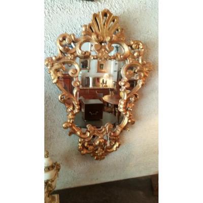 Miroir Louis XIV en bois doré.