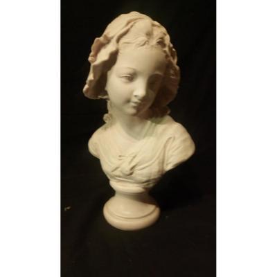 """Buste """"Jeune fille"""" signé Grinam, pierre calcaire."""
