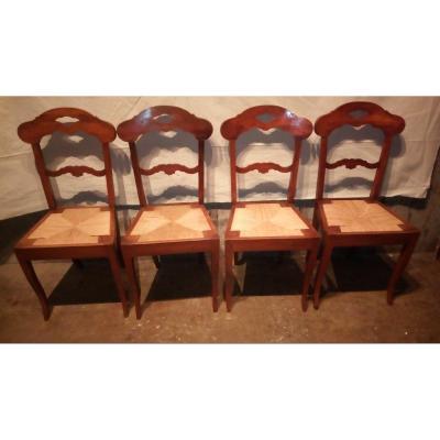 Série de quatre chaises paillées d'époque Restauration.