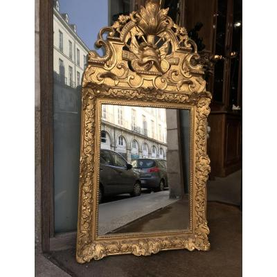 Regency Mirror In Carved And Gilded With Openwork Fronton.