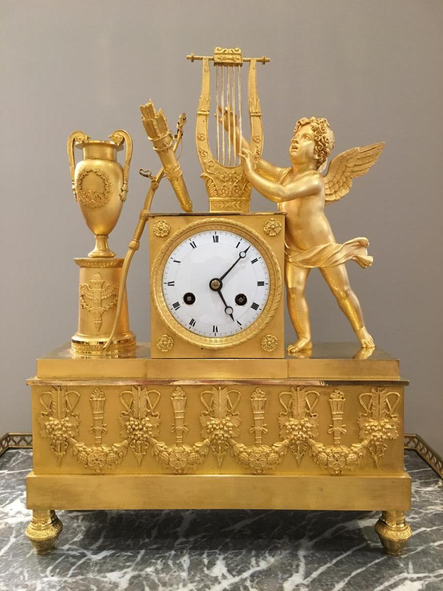 Pendule «Cupidon jouant de la lyre» Époque Empire