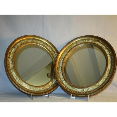 PAIRE DE MIROIRS en bois doré et peints en trompe-l'oeil XIXe miroir ovale