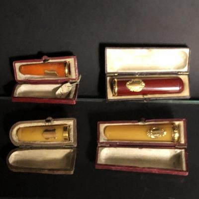 4 Antique Cigarette Holders In Gold And Amber In Case New State Jewelery Background