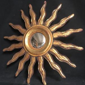 MIROIR SOLEIL SORCIERE 47,5 cm en bois doré  bombé et déformant curiosité sorcière