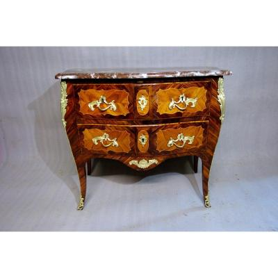 Louis XV period chest of drawers curved on all sides, in rosewood veneer in violet wood frames. Stamped by cabinetmaker Nicolas-Pierre SEVERIN. It opens with two drawers at the top and a large drawer from the bottom Beautiful quality of gilded bronzes, very good general condition Nicolas-Pierre Séverin (1728 - December 27, 1798) Cabinetmaker. Paris. Master on July 26, 1757. He established his account in rue Dauphine and took part in the restoration of a certain number of Boulle marquetry furniture found in royal residences. Nicolas-Pierre Séverin was born in 1728. He was the son, and later became his pupil, of Pierre Séverin, the privileged craftsman of the Faubourg Saint-Antoine. Although he obtained his master's degrees in 1757, he did not register them until 1764. He settled in rue Dauphine, where he would work until the end of his life.