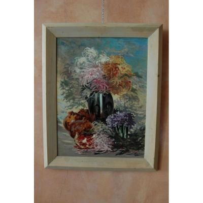 Nature morte fleurs et fruits, huile sur toile signée M Larue.