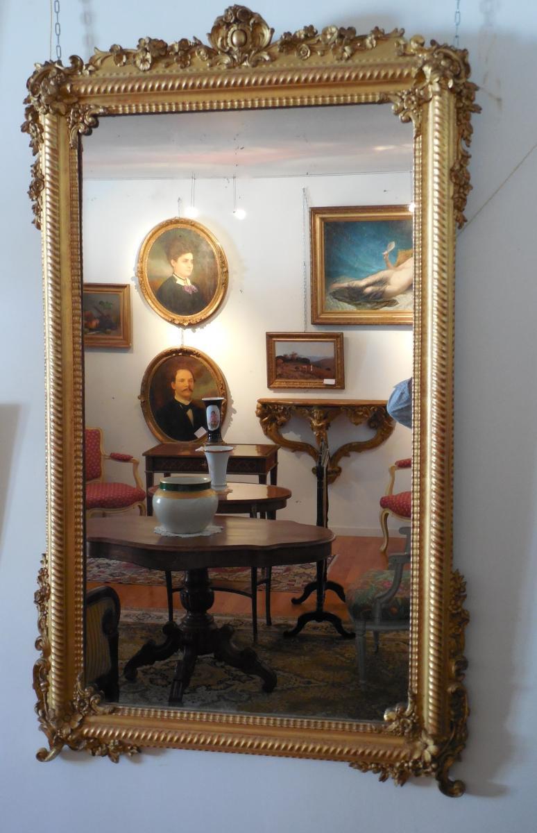Miroir  en bois doré à la feuille,transition LXV-LXVI,époque XIXème