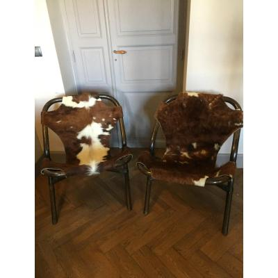 Pair Of Rattan And Cowhide Armchairs