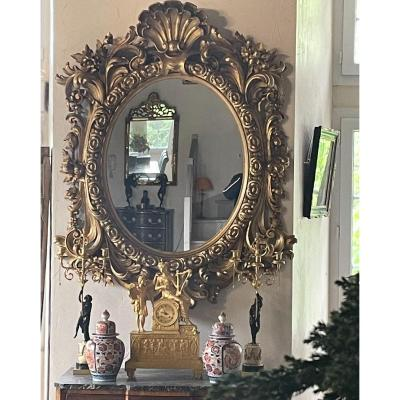 Large Oval Mirror Of Venetian Palace In Carved And Gilded Wood From The XIXth Century