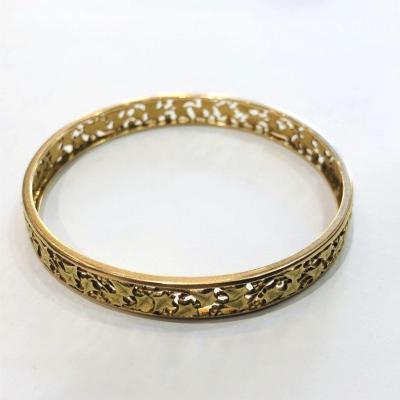 Bracelet jonc en or 18k à motif ajouré de feuilles de lierre, Belle époque, fin 19ème