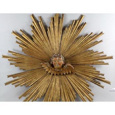 Important Soleil en bois sculpté et doré - XVIIIème