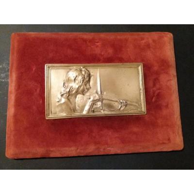 "Block of gilt métal,the ""Violonist""signed Alexandre Charpentier,on a velvet stand."