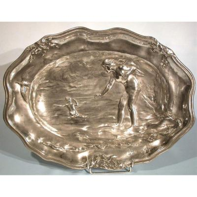 <strong>By L&eacute;eon PILET (1839-1916)<br /> <br /> Large oval Pewter WALL PLATE with high relief decoration of two young bathers.<br /> Signature of the artist and foundry mark &quot;Etain Garanti&quot; by Jean-Maurice P&eacute;tizon.<br /> Length: 35.7 cm.<br /> PARIS, around 1900. </strong><br /> <br /> A zone of oxidation and pitting<br /> Model reproduced in the work cited below<br /> Bibliography: &ldquo;Etains 1900&rdquo; by Philippe DAHHAN.<br /> <br /> ******************************************************************<br /> <strong>Website: http://www.commenchal-expert-etains.com </strong><br /> <br /> ******************************************************************<br /> <br /> PAYMENT<br /> <br /> - By French check payable to COMMENCHAL Jean-Claude<br /> - By bank transfer payable to COMMENCHAL Jean-Claude<br /> IBAN: FR7630027160990002011940139<br /> BIC: CMCIFRPP<br /> - By Paypal transfer to jc.commenchal@orange.fr There will be an additional cost of 3 \% TTC of the price indicated to compensate for the charges levied by this banking operator<br /> <br /> GUARANTEE<br /> <br /> Jean-Claude COMMENCHAL, expert specialist in tins of all ages, guarantees the authenticity of the object described above. A detailed descriptive invoice including a photograph will be given to the purchaser on request.<br /> <br /> SHIPPING<br /> <br /> Sent to France by &quot;Colissimo&quot; followed within a maximum of 48 hours. With recommendation and insurance on request. Postal transport is offered to mainland France.<br /> Sending to the whole world by &quot;Colissimo&quot; recommended. With insurance on request. To know the shipping costs to Europe or the whole world, click on &quot;Buy online&quot; and select your country, or contact me by email.<br /> <br /> ASK A QUESTION<br /> <br /> French-speaking buyers: by phone or email.<br /> Non-French speaking buyers: exclusively by email.<br /> <br /> ******************************************************Ref 16755