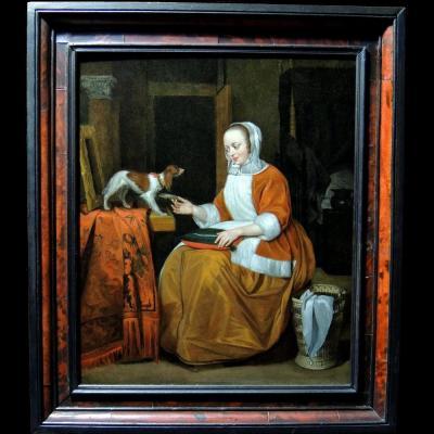 Ecole hollandaise du XVIIème siècle - Dame conversant avec son chien