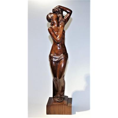 <strong><em><u>Gilbert PRIVAT<br /> Large Sculpture entitled &quot;ROSES&quot;, in rosewood</u></em> wood made in direct carving edited by the company D.I.M. (Modern Interior Decoration) in 1929.<br /> Underneath bears the mark &quot;Made in France&quot; and n &deg; 7A<br /> <u><em>Exhibitions</em></u>: Salon des Artistes D&eacute;corateurs in Paris in 1928 and at the DIM Gallery in 1929<br /> Bibliography: Furniture and Decoration, carved wood presented by DIM. (02/1929) page 75. Odette Gilbert Privat - MO Lerf&egrave;vre, &quot;Gilbert Privat&quot; Imprimerie alen&ccedil;onnaise, 1997 confirms on page 69 &quot;that a rosewood proof was exhibited at the Salon des Artistes D&eacute;corateurs in 1928&quot; and on page 44 that a few copies were published in 1929 by the company DIM.<br /> Size: height 74 cm, base 18 cm x 12.5 cm.<br /> <em><u>Period 1929<br /> Superb Condition</u></em><br /> <u><em>Gilbert PRIVAT (1892-1969)</em></u><br /> French sculptor and painter, great admirer of Rodin and Bourdelle, Gilbert Privat expressed his talent in the aesthetic research of the female body combined with purity, softness and sensitivity.<br /> The Boulogne Billancourt 1930s Museum honors him by presenting a hundred of his works from a donation of his wife who was also his most faithful muse.<br /> <u>Museums:</u> Paris, Lille, Roubaix, P&eacute;rigueux, Lourdes.<br /> <u>Numerous exhibitions and commissions for public monuments</u></strong><br /> &nbsp;